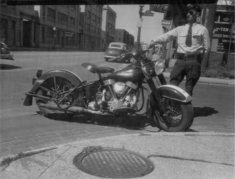 1950 - IPD motorcycle officer, Joseph Faires, 10th & Capitol Ave.